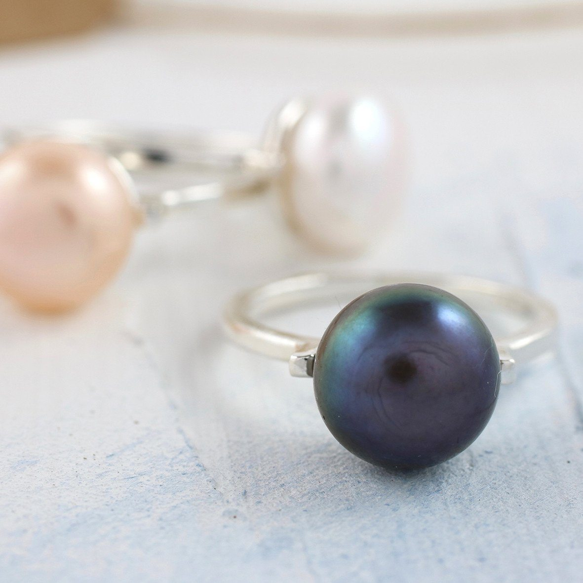 peacock pink white pearl ring
