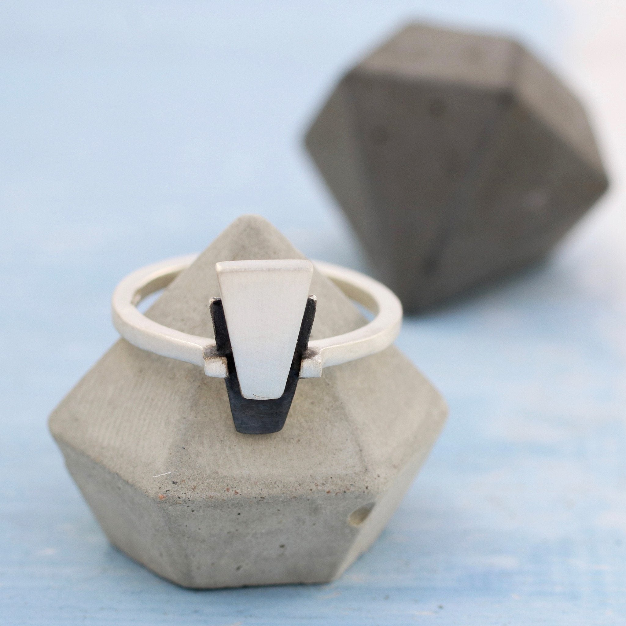 geometric silver and black jewellery