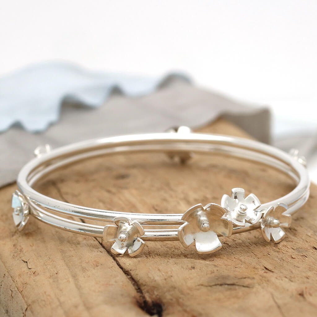 Handmade silver flower stacking bangles
