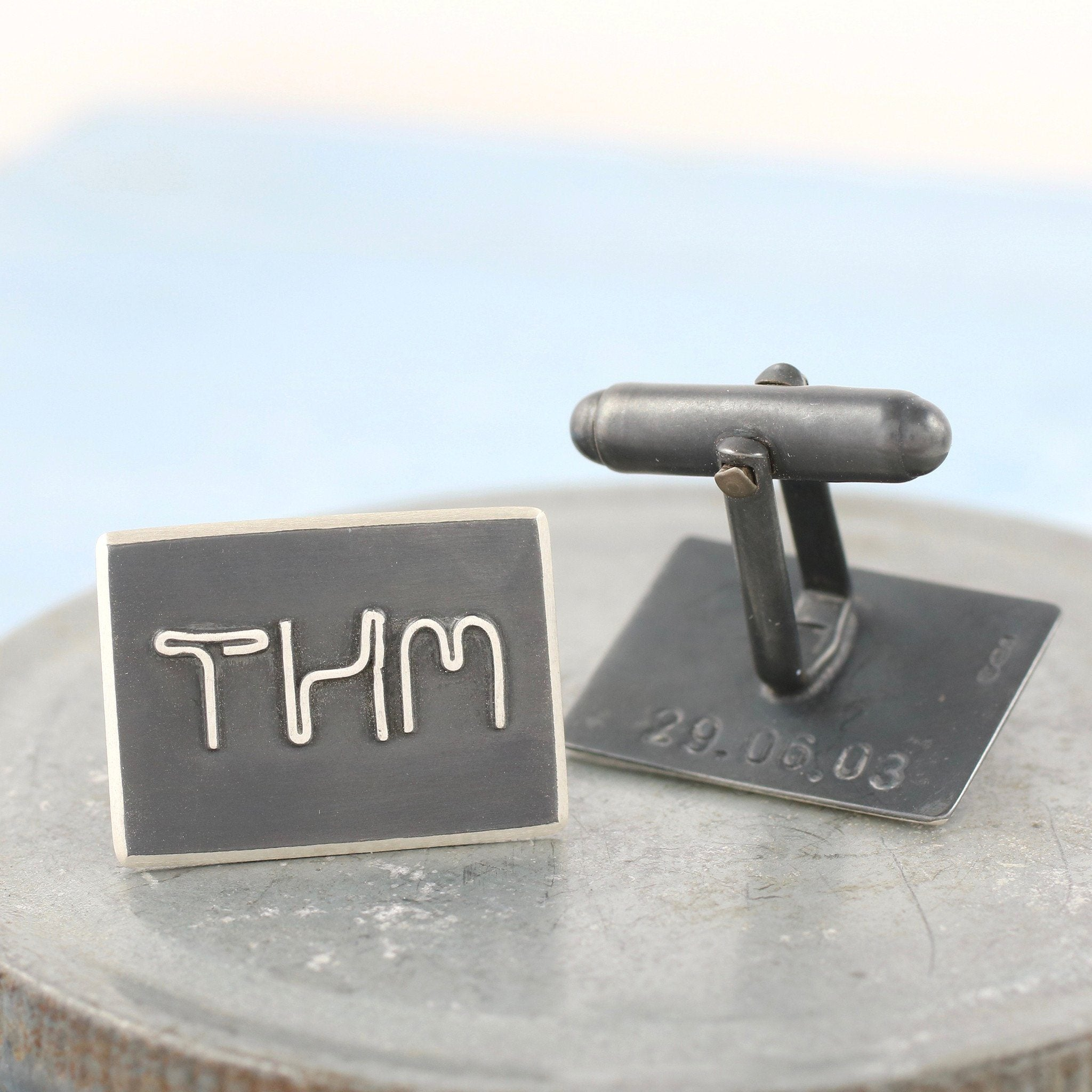 black and silver name cufflinks