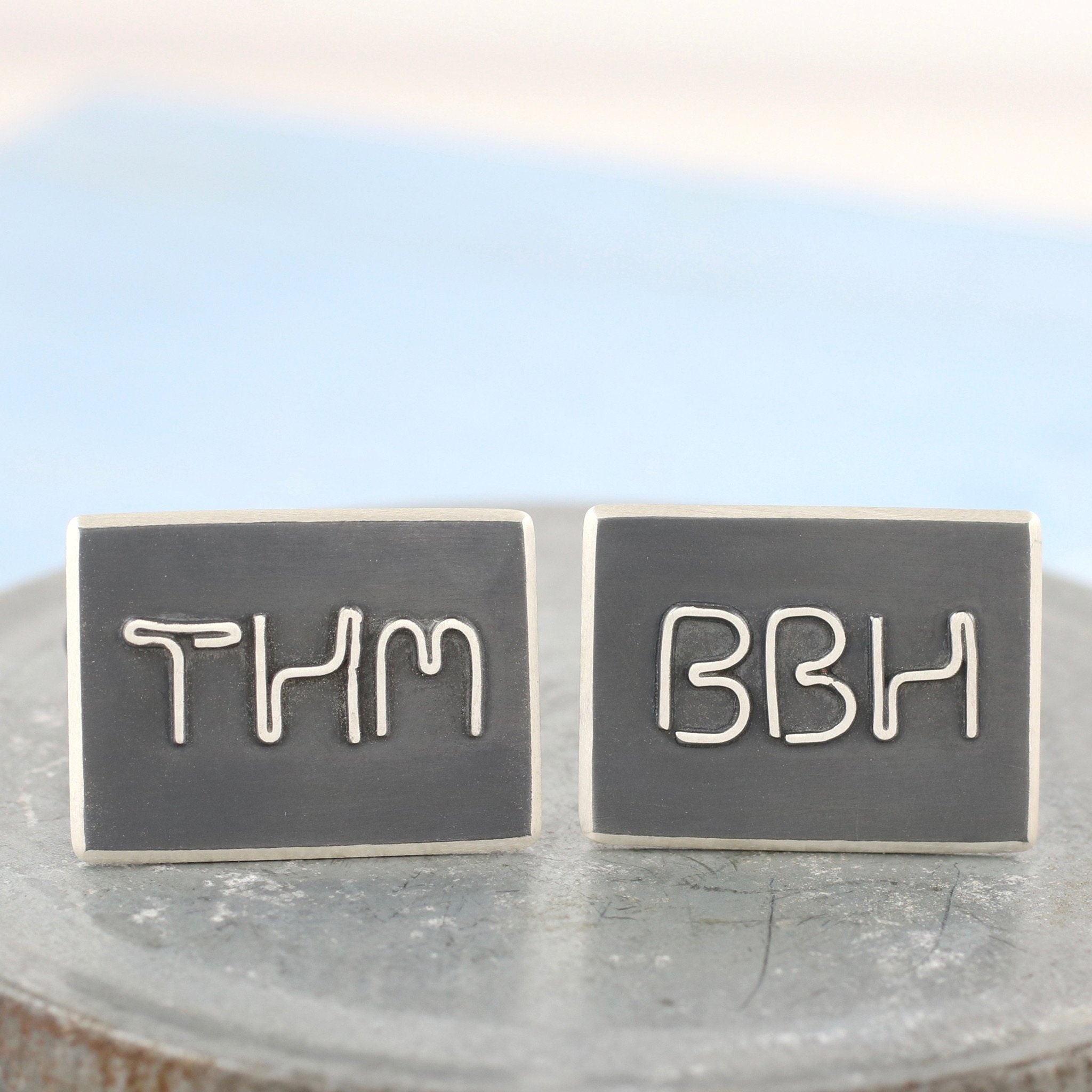 monogram black and silver cufflinks