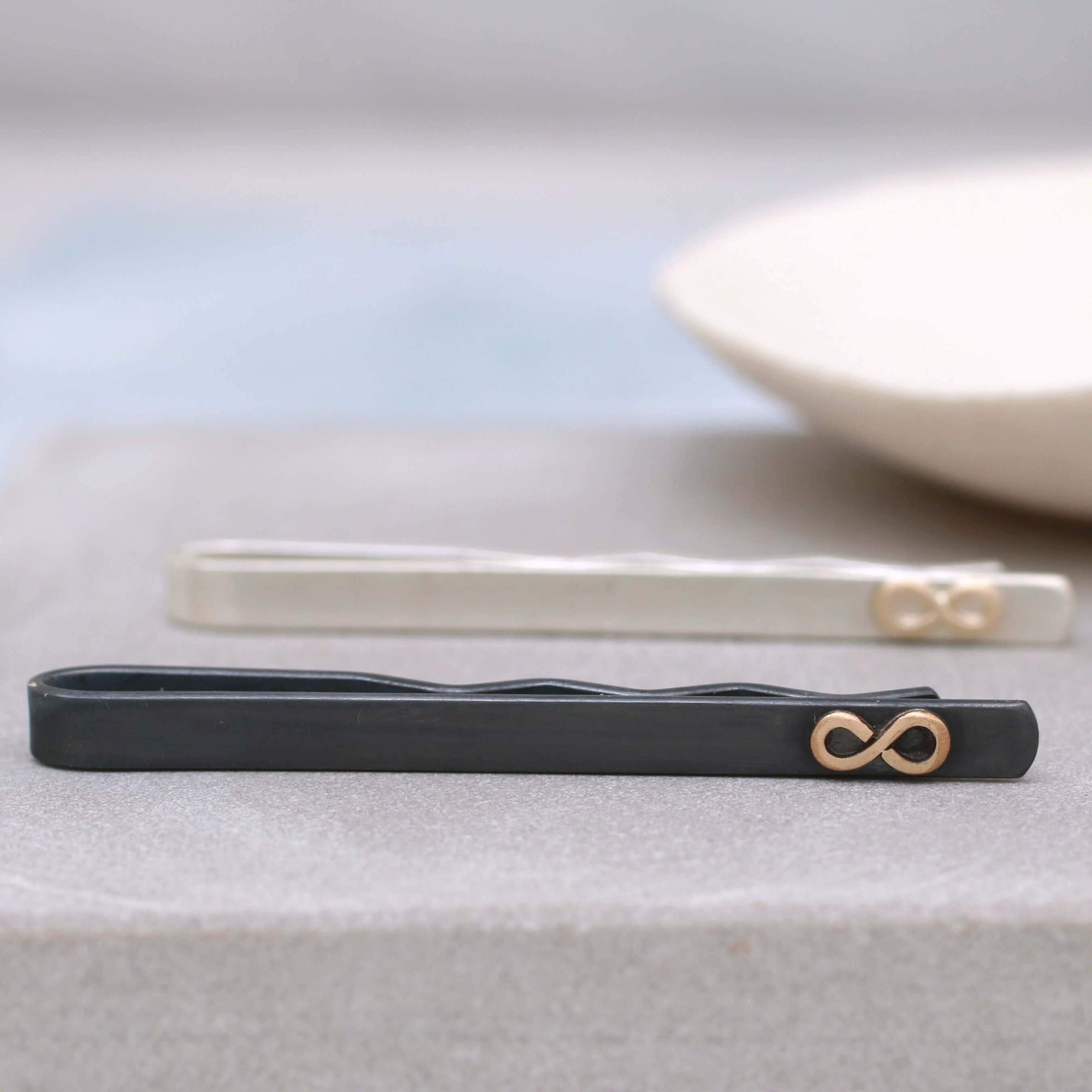 Black And 9ct Gold Tie Clip With Infinity Symbol