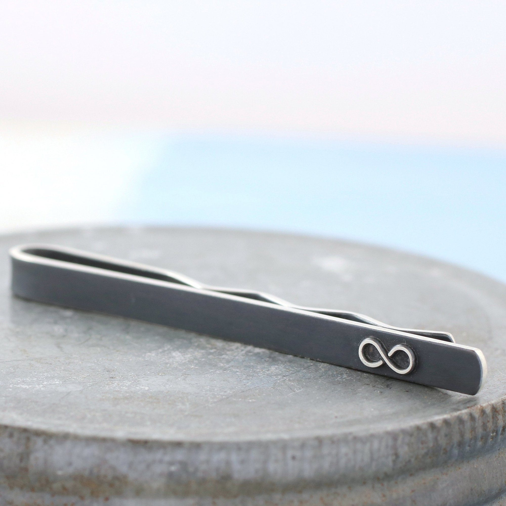 Oxidised Black Tie Clip With Infinity Symbol