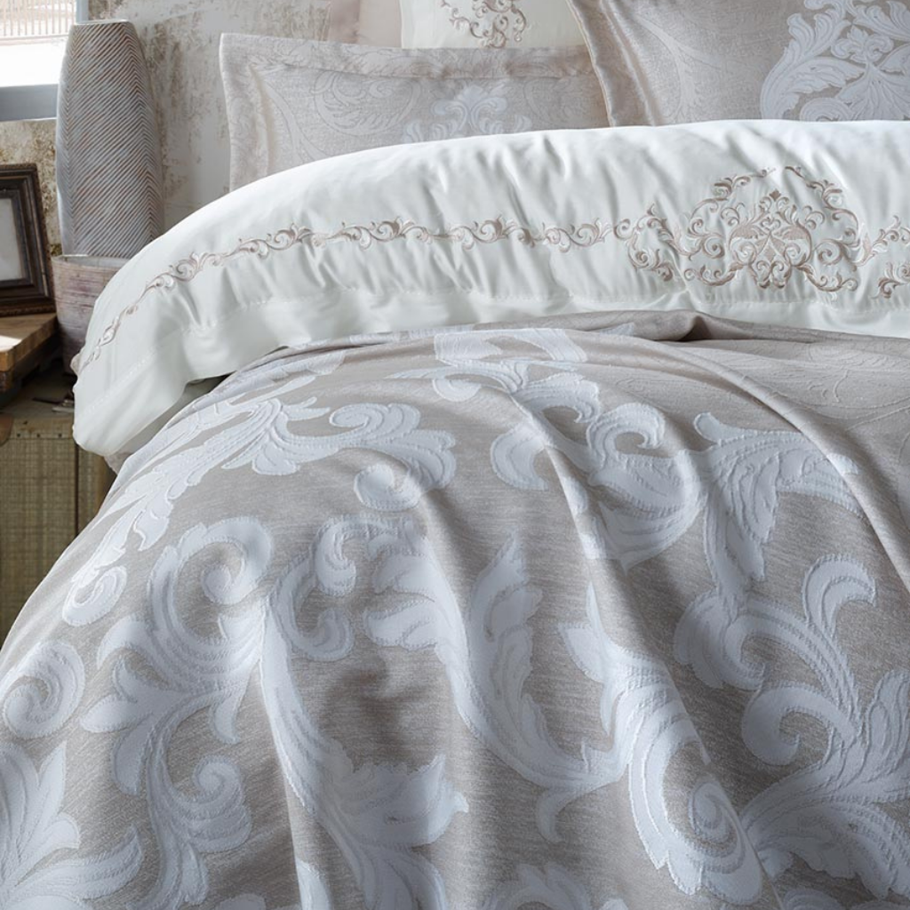 Jacquard, bronze  color bedspread and white duvet cover adorned with baroque design embroideries