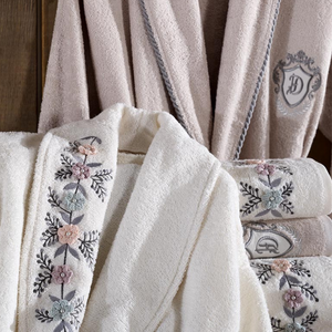 Ecru-cream women`s robe and towels decorated with  knitted 3D flowers