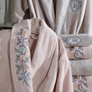 Powder-pink bamboo-cotton women`s robe decorated with knitted 3D flowers