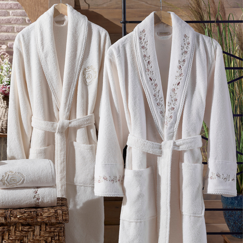 Cream-ecru bathrobe and bath towel set in a modern bathroom