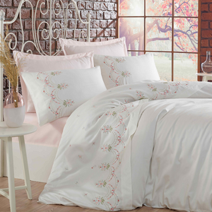 White bedroom designed with powder-pink bed sheet and white duvet cover