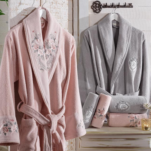 Bathroom designed with  powder-pink, cotton women`s robe and grey men`s robe