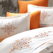 Load image into Gallery viewer, Orange and yellow rug patterns and tassels pairs with orange pillows