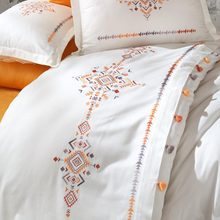 Load image into Gallery viewer, Orange, yellow and grey embroideries and tassels pairs with orange, cotton-sateen bed sheet.