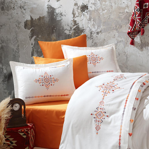Traditional Turkish rug designs embroidered on white duvet cover and shams
