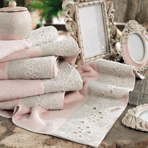 Elegant bathroom decorated with photo frames and powder-pink color, Turkish hand towels