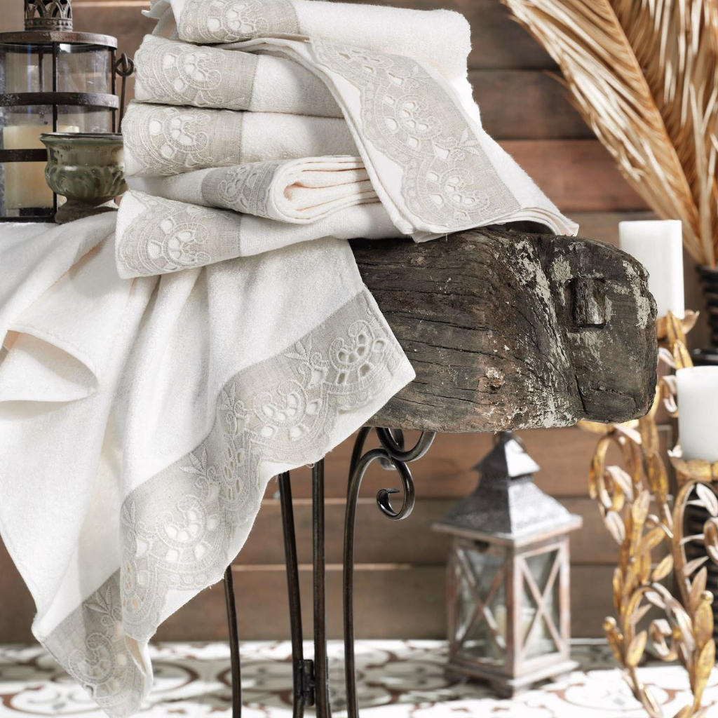 Authentic style room decorated with candles and cream-ecru color hand towels