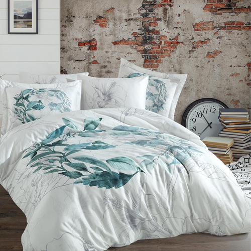 Shades of green and grey leaves and floral designs on white duvet cover and shams in a modern room