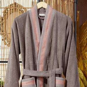 Collars and cuffs of modern, brown men`s robe is decorated with jacquard