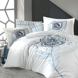 Cool bedroom designed with bedding in grey, blue tones on white duvet cover and shams