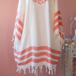 Women hand-made dress with orange stripes and tassels at the borders