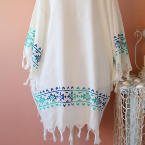 Turkish, beach-dress/ kimono which has hand-made prints and tassels at the borders