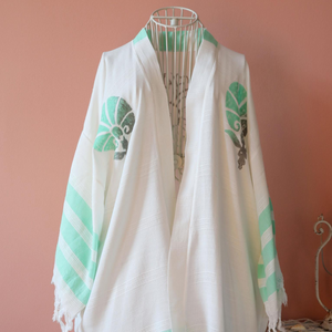 Cotton-bamboo beach dress decorated with green flower designs and stripes