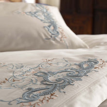 Load image into Gallery viewer, Royal blue color embroideries on white, cotton-sateen duvet cover and shams