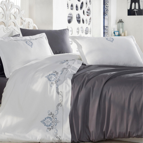 White bedroom decorated with duvet cover in anthracite and white color that pairs with anthracite bed sheet and 2 pillowcases.