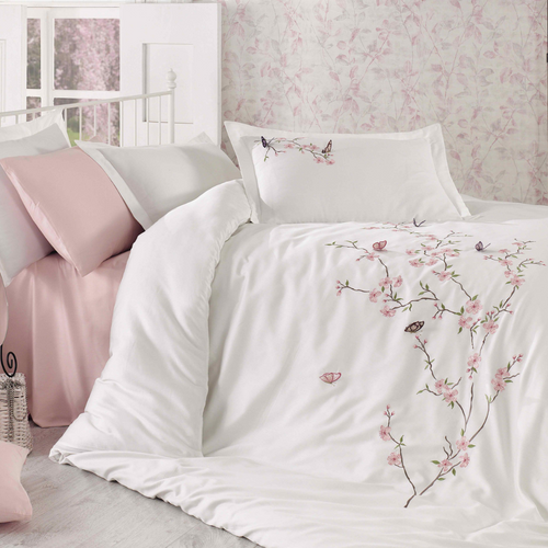 Fresh bedroom designed with white duvet cover, fully decorated with pink flowers and butterfly embroideries