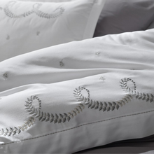 Load image into Gallery viewer, Silver-grey embroideries on white duvet cover and pillowcases combines with grey bed sheet.