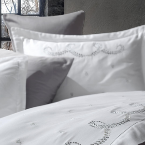 Silver-grey leaf embroideries on white quilt cover and shams