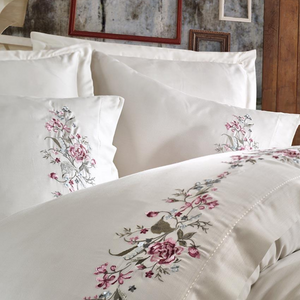 Creme quilt cover and pillowcases are decorated with bordeaux and brown color floral emroideries