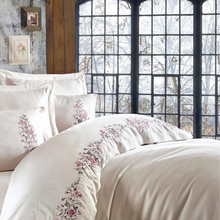 Load image into Gallery viewer, Modern interior designed with creme quilt cover and pillows, decorated with floral ornaments.