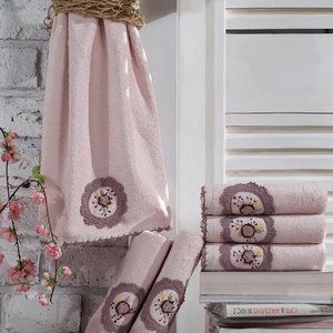 Fresh room decorated with books, flowers and pink, Turkish hand towels