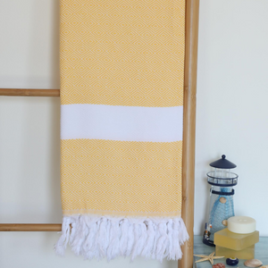 Yellow Turkish beach towel has diamond design