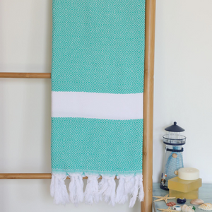 Turkish beach/bath towel in green color has diamond designs on it