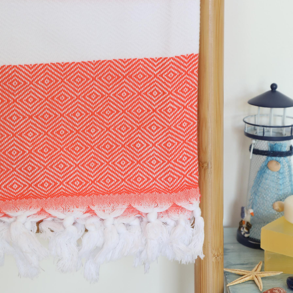 Turkish towel in coral-white colors has diamond designs