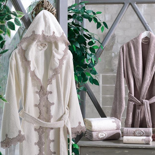 Fresh bathroom designed with bathrobe set for couples
