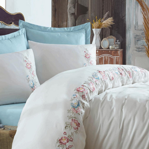 Classic bedroom is refreshed with white duvet cover and blue bed sheet, pillows