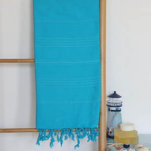 Blue Turkish towel that is very soft and absorbant