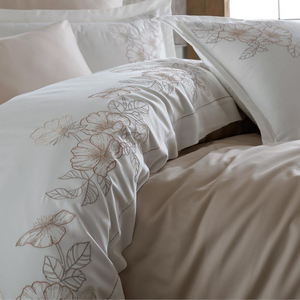 Brick and grey color floral ornaments on duvet cover and shams pairs with beige bed sheet