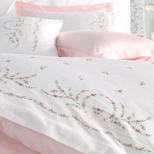 White duvet cover and shams decorated with delicate, pink and green floral embroideries