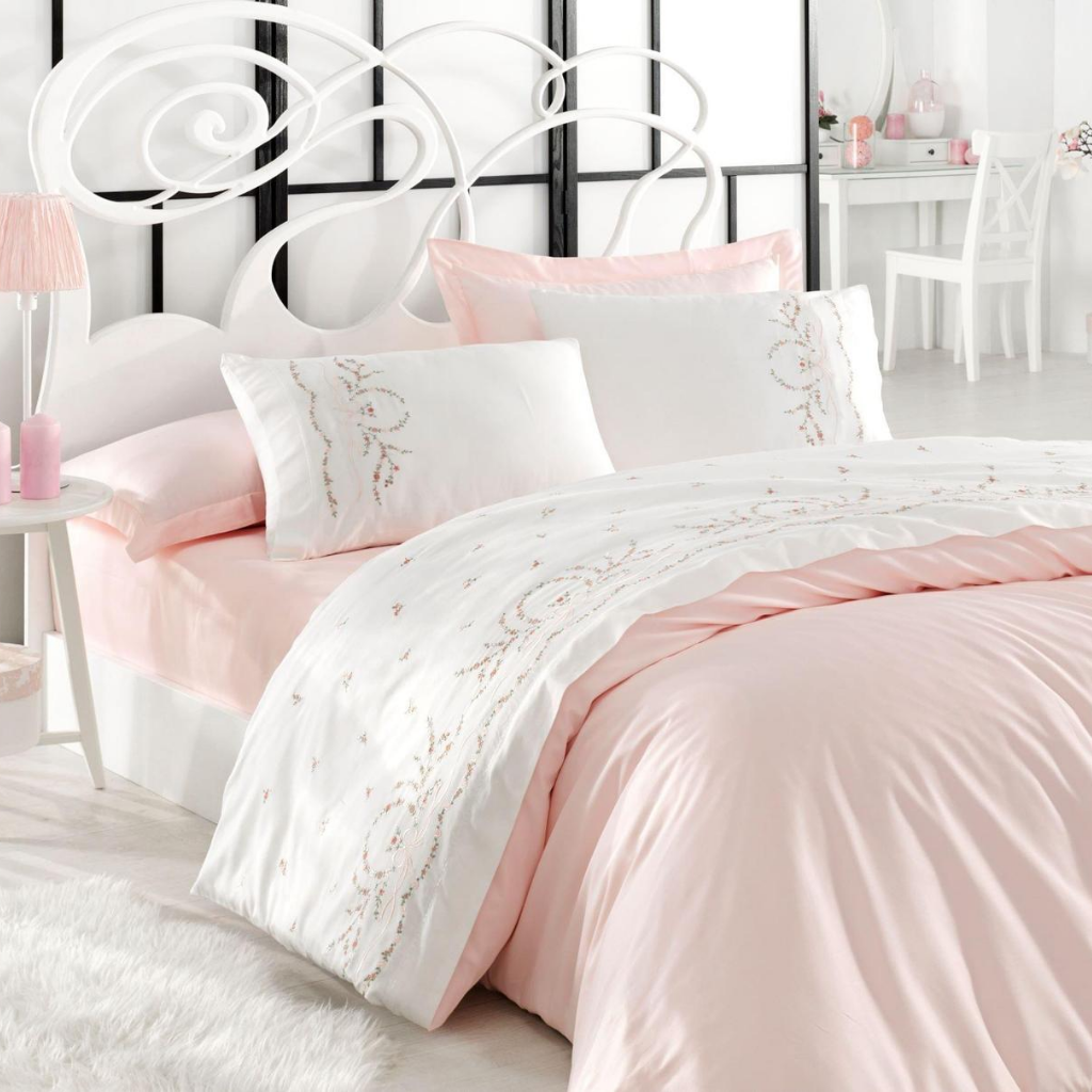White bedroom decorated with pink-white, cotton-sateen bedding set.
