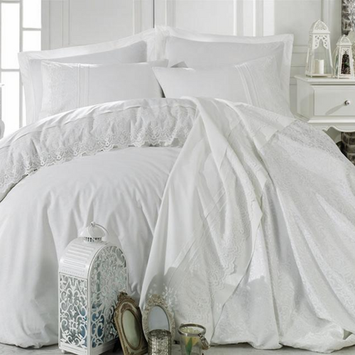 Bridal bedroom decorated with white furnitures and white, cotton-sateen  bedding.