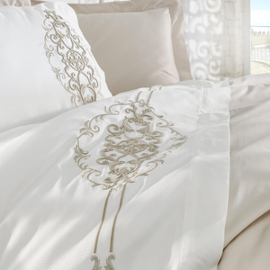 Cotton-sateen, white duvet cover and shams are ornamented with golden bronze, damask pattern embroideries