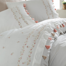 Load image into Gallery viewer, White duvet cover and pillows decorated with pink and beige tassels and floral embroideries