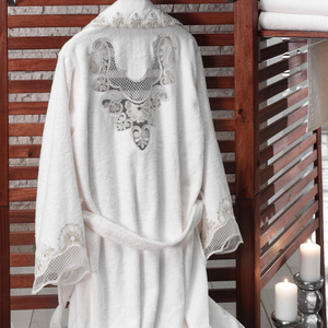 Collar, cuffs and back of cotton women`s robe is ornamented with heart-shape lace