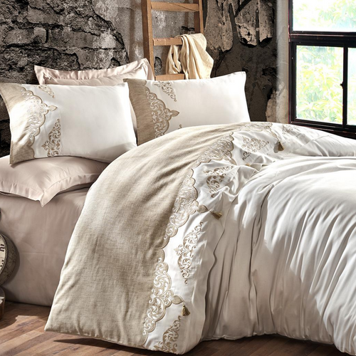 Vintage bedroom designed with a bed linen set in antique bronze color and white