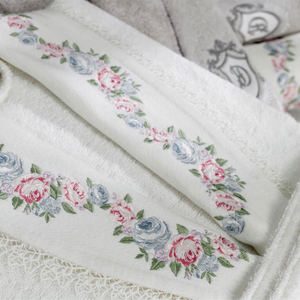 Ecru color women`s robe and collars are decorated with floral embroideries and lace