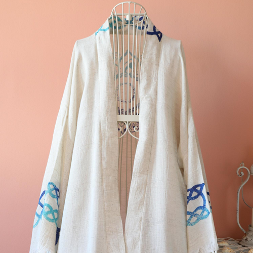 Linen-cotton blend, hand-made kimono has modern, blue designs on it