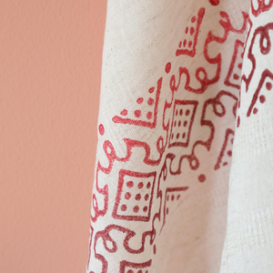 Ecru linen shawl has red, organic dyed prints