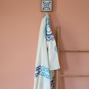 Linen shawl/scarf has blue, hand-made prints with organic dye
